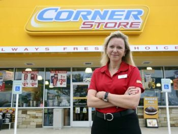 CEO Kim Bowers stands in front of a CST Brands store. Photo from mySanAntonio.com