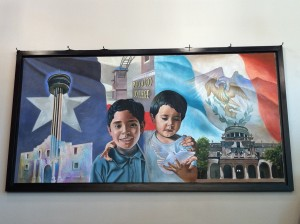Mural de la hermandad hangs at Palo Alto College's Ozuna Library.